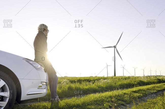 Schleswig-Holstein, Germany - June 15, 2010: Woman in a wind farm
