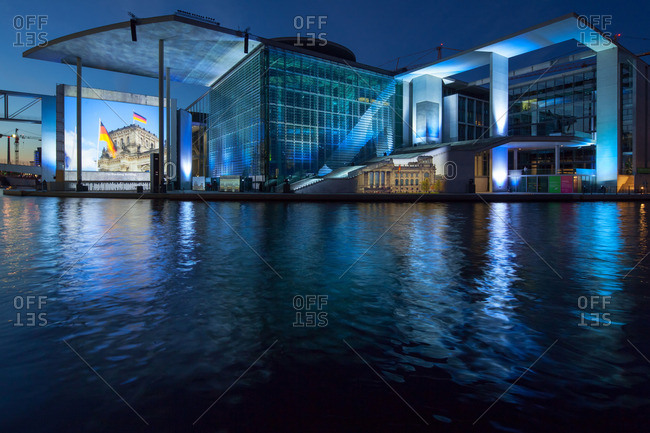 Berlin, Germany - July 15, 2012: Night view of the Marie-Elisabeth Luders House of the parliamentary complex with a video projection and light show