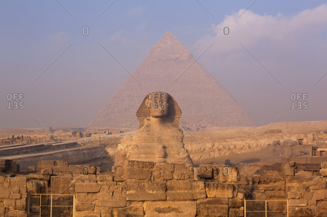 Dusk view of the Sphinx in front of the Pyramid of Khafre, Cairo, Egypt