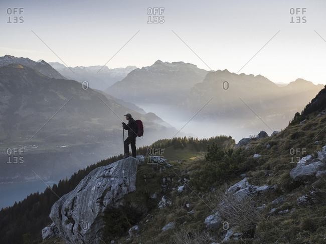 St. Gallen, Switzerland - November 15, 2012: Backpacker on a foggy morning in the Alps
