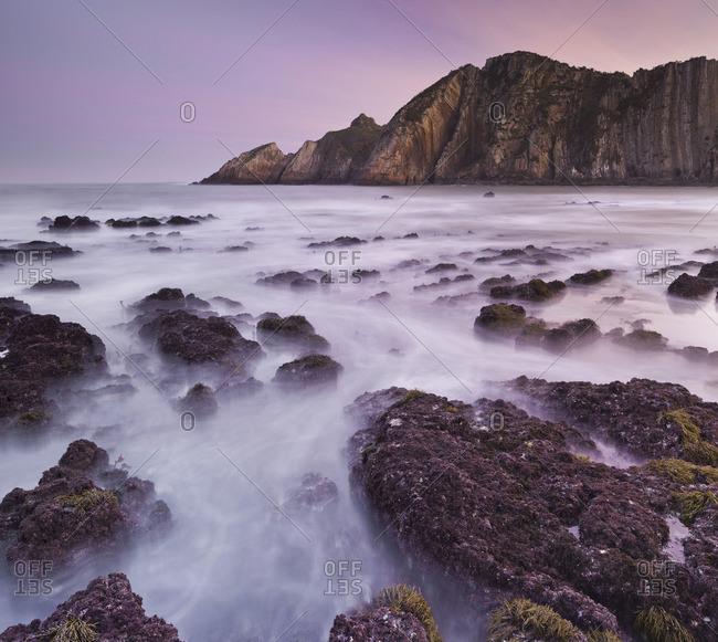 Long exposure of an ocean swell at Playa del Silencio (Beach of Silence), Spain