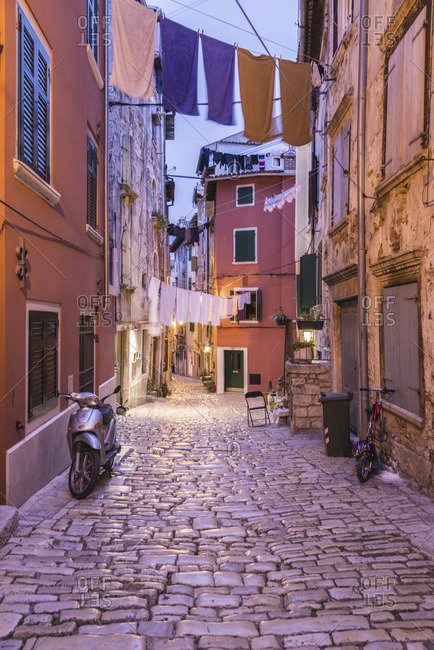 Rovinj, Croatia - October 15, 2012: A cobblestone street view at dusk
