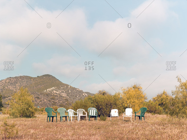 Empty lawn chairs in a field