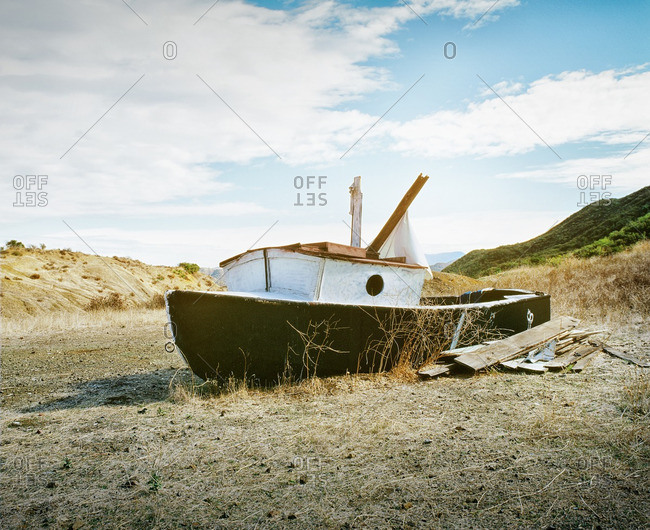 Old abandoned boat wrecked on shore