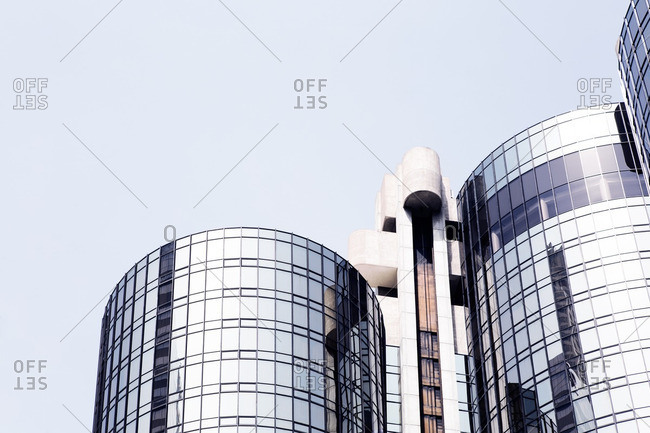 Low angle view of round modern buildings