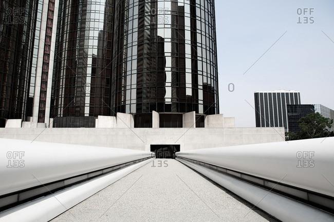 Pedestrian bridge leading to entrance of a modern building