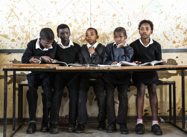 - July 30, 2010: African schoolchildren seated together at long table