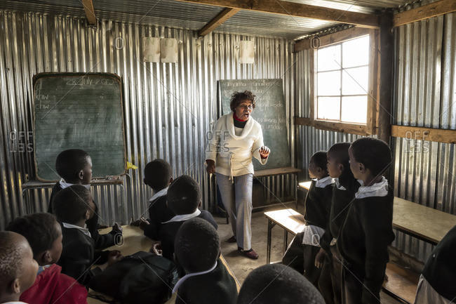 - July 30, 2010: Teacher going over language lesson in African classroom