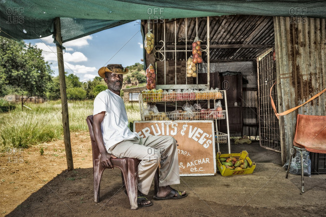 - February 5, 2015: Man selling fruits and vegetables at roadside stand