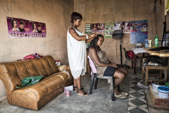 - February 5, 2015: Hairdresser working client's hair in beauty salon