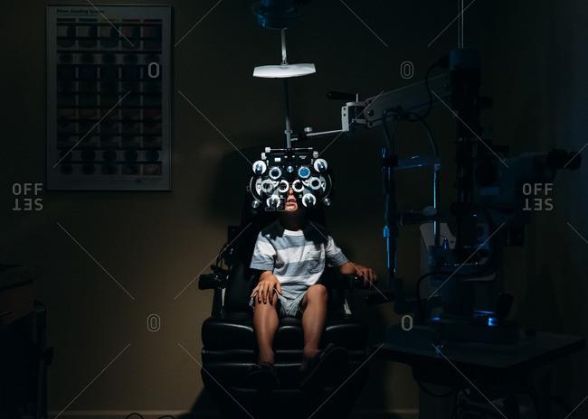 - July 28, 2016: Boy getting eye exam at optometrist's office