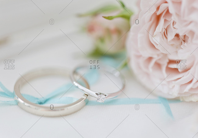 Close-up of wedding rings with flowers