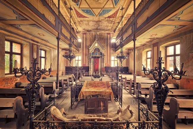 October 10, 2015: Pews in a decaying abandoned synagogue in Romania
