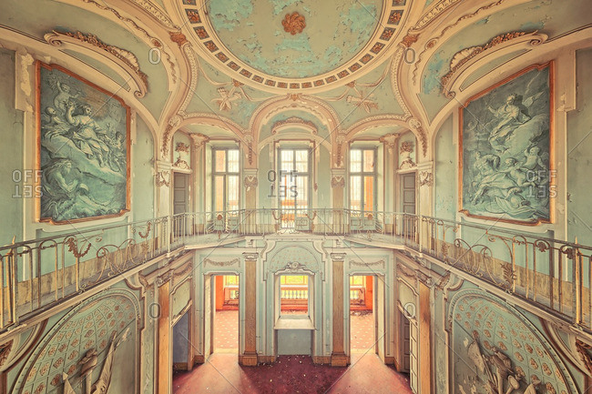 February 6, 2016: Paintings on the walls of a grand hall in an abandoned historic mansion