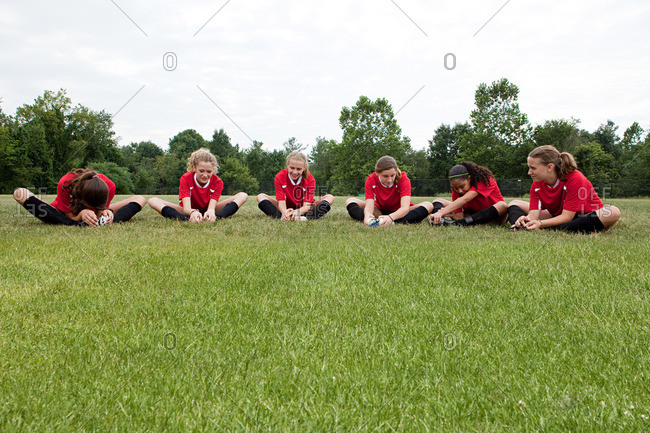 Five girl soccer players on field