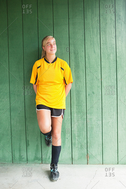 Portrait of a girl soccer player in a yellow jersey