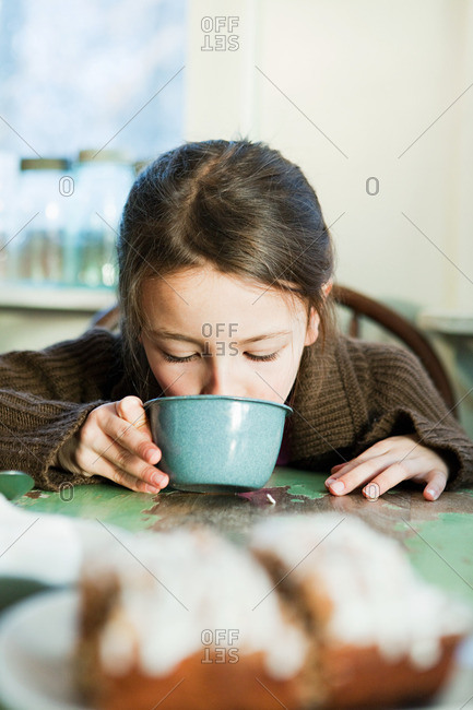 Young girl drinking hot drink