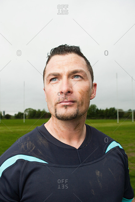 Portrait of a rugby player looking off in the distance