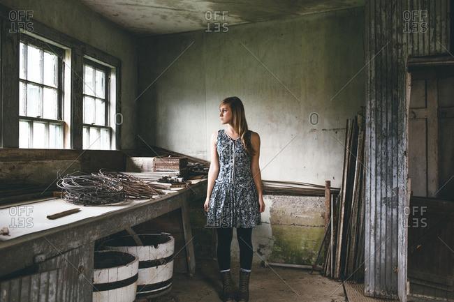 Woman standing in rustic workshop