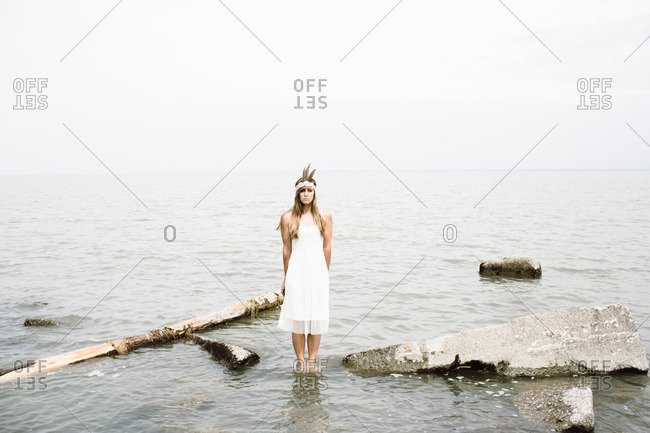 Woman in feather headband in water