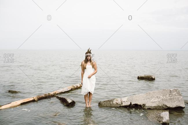Woman in white dress in water