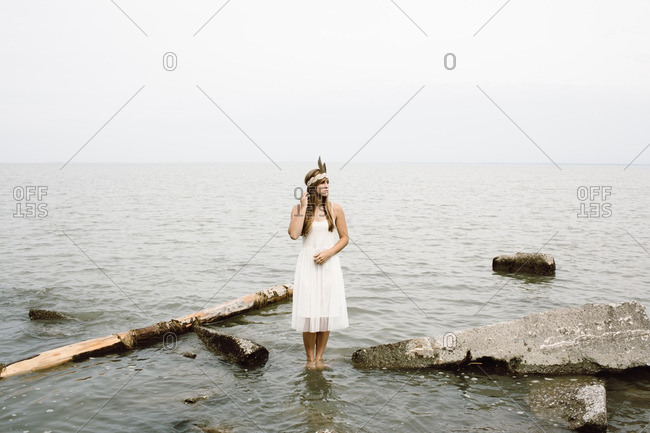 Woman in a white dress in water