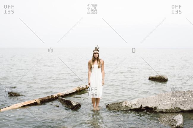 Woman standing still in water