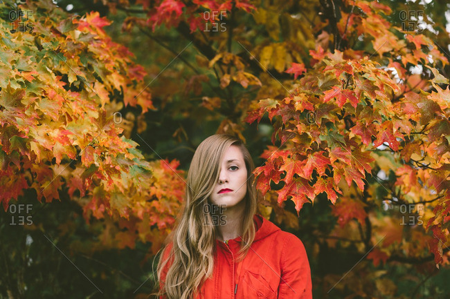 Woman among autumn branches