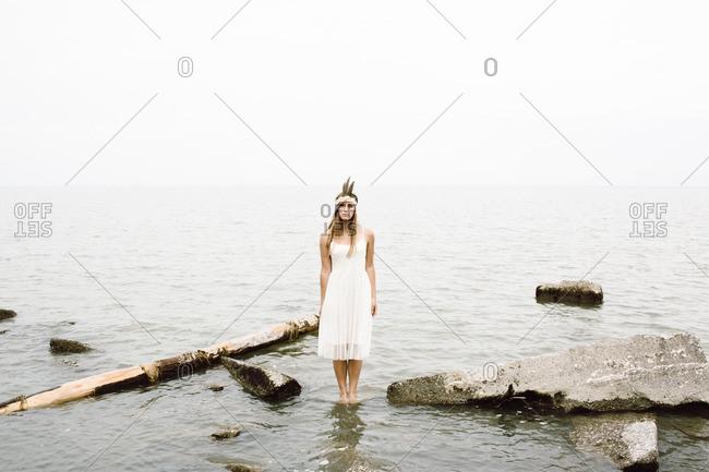 Woman in water standing still