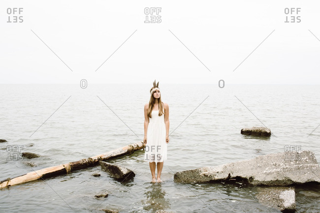 Woman with white dress in water