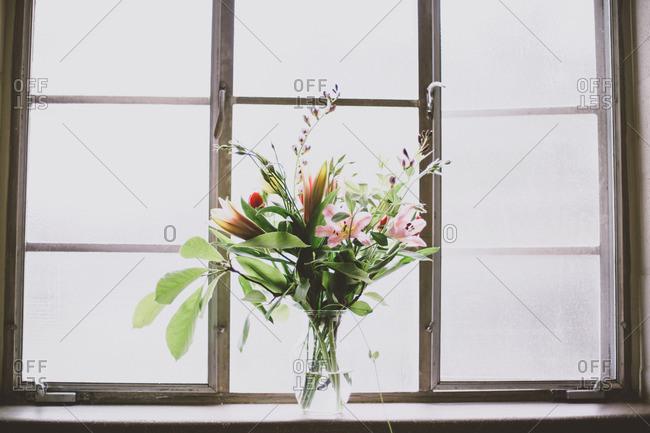 Flower vase in a sunny window