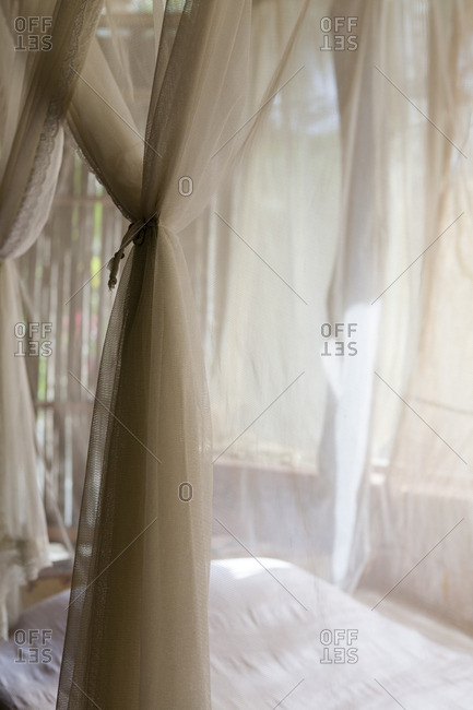 Mosquito netting around bed - Offset
