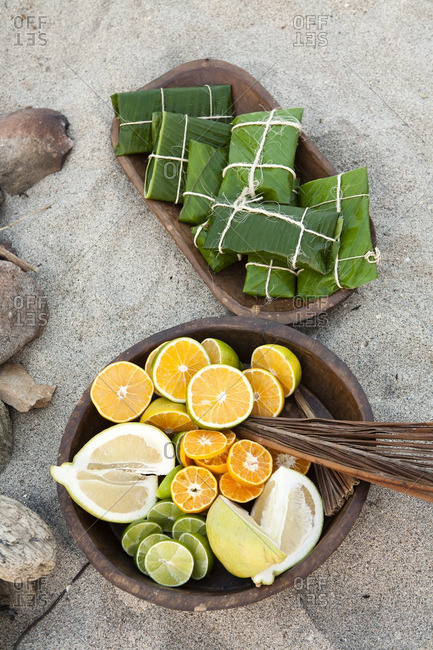 Banana leaf wraps and citrus fruit