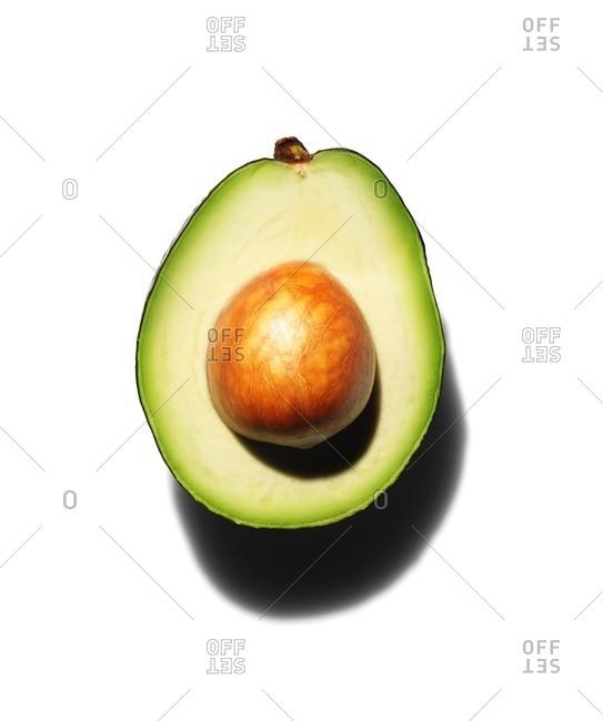 Avocado half with pit