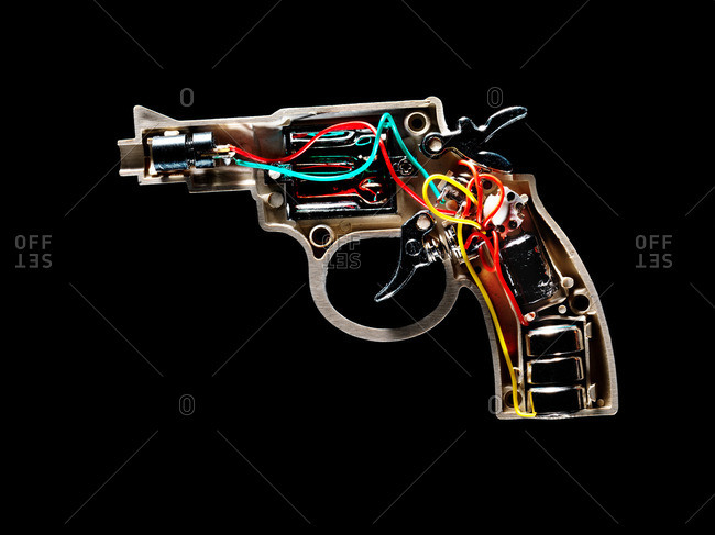 A handgun with wires