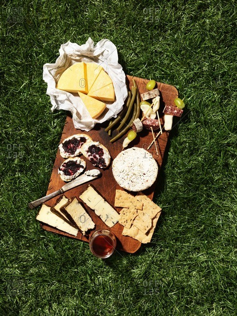 A cheese board on ground