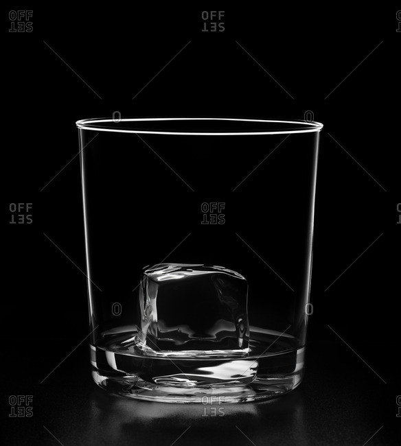 Ice cube melting in glass