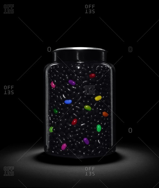 Jelly bean jar on dark background