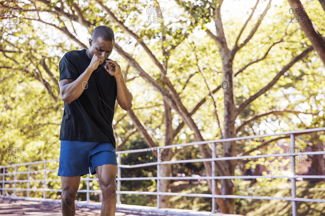 Dedicated male athlete jogging in park
