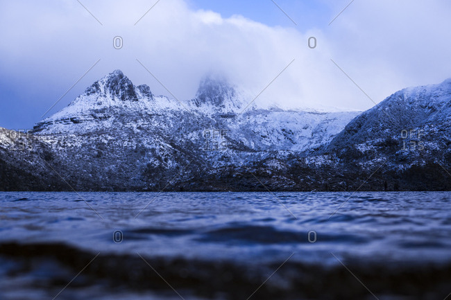 Cradle Mountain blanketed in snow with views from Dove Lake water level