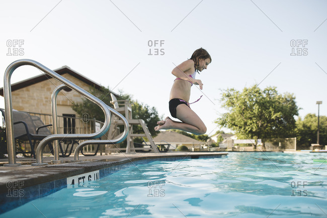 Girl jumping from a diving board