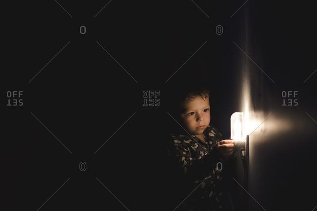 Boy by nightlight in dark