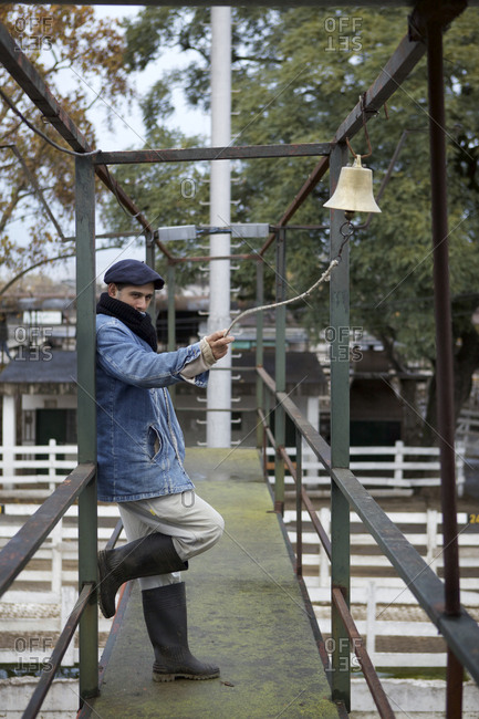 Buenos Aires, Argentina - May 31, 2016: Man rings bell at Liniers Cattle Market, Buenos Aires