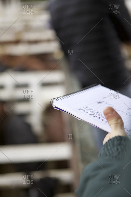 Buenos Aires, Argentina - May 31, 2016: Man taking notes at livestock auction, Buenos Aires