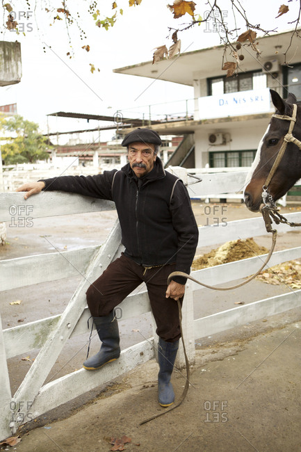 Buenos Aires, Argentina - May 31, 2016: Portrait of a gaucho and his horse at the cattle market in Buenos Aires