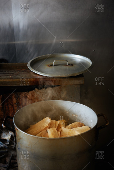 Tamales steaming in pot