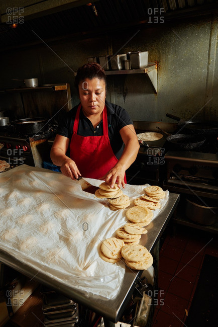 - April 28, 2016: Woman preparing sope in Mexican restaurant