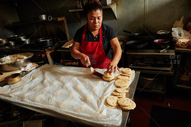 - April 28, 2016: Woman making sope in Mexican restaurant