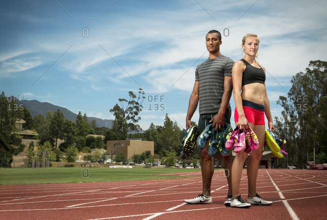 April 30, 2015: Olympians Ashton Eaton and Brianne Theisen Eaton holding running shoes