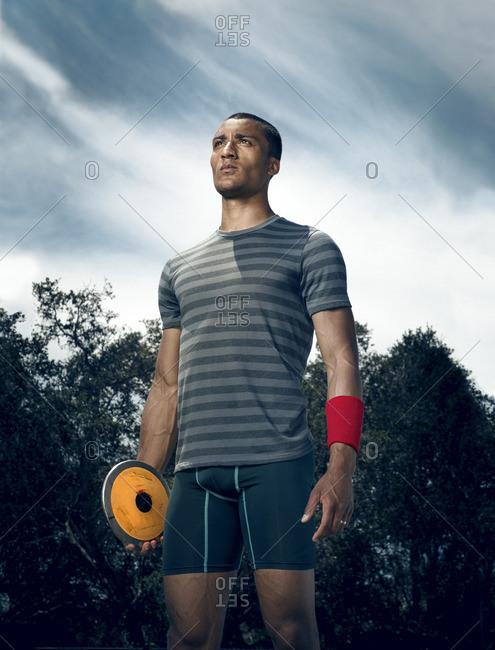 April 30, 2015: Olympic Athlete Ashton Eaton holding discus